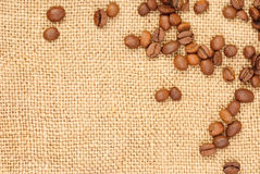 Coffee beans  on burlap Stock Image