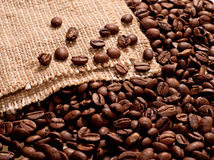 Coffee beans on burlap background Stock Images
