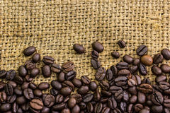 Coffee beans on burlap Stock Photos