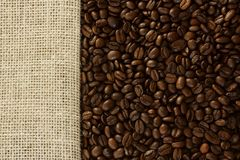 Coffee beans  and burlap background Royalty Free Stock Photography