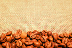 Coffee beans on burlap background Royalty Free Stock Photo