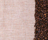 Coffee beans on burlap background Stock Photos