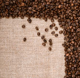 Coffee beans on burlap background. This high quality photograph represents Coffee beans on burlap background Stock Image