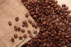 Coffee beans and burlap Stock Photography