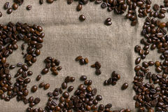 Coffee beans on burlap background. Royalty Free Stock Photos