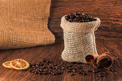 Coffee beans in burlap bag Royalty Free Stock Images