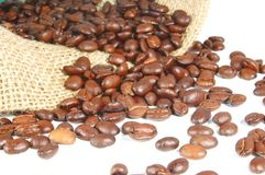 Coffee beans and burlap bag. Coffee beans are drop out of a burlap bag Royalty Free Stock Image