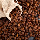 Coffee beans in a burlap bag. Can be used as background Stock Photography