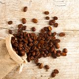 Coffee beans in a burlap bag. Can be used as background Stock Photos