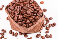 Coffee beans in a burlap bag isolated Stock Images