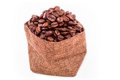 Coffee beans in a burlap bag isolated on white background Royalty Free Stock Photo