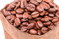 Coffee beans in a burlap bag isolated on white background Royalty Free Stock Image