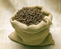 Coffee Beans In Burlap Bag Lit Overhead Stock Photo
