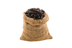 Coffee beans in burlap bag. On white background Royalty Free Stock Photos