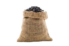 Coffee beans in burlap bag. On white background Royalty Free Stock Image