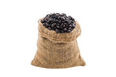 Coffee beans in burlap bag. On white background Stock Image