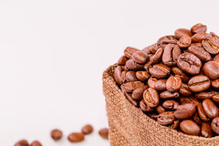 Coffee beans in a burlap bag  on white background Stock Images