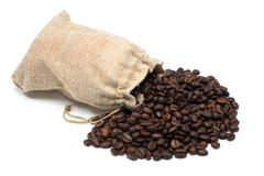Coffee beans with burlap bag. On white background Royalty Free Stock Photos