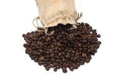Coffee beans with burlap bag. On white background Royalty Free Stock Photo