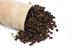 Coffee beans with burlap bag. On white background Royalty Free Stock Image