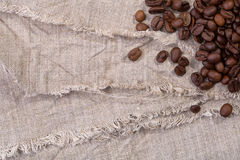 Coffee beans on burlap fabric Stock Photography