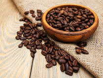 Coffee beans and burlap fabric Stock Image
