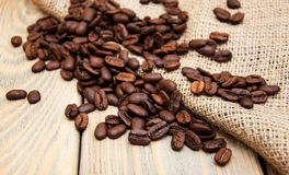 Coffee beans and burlap fabric Royalty Free Stock Image