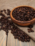 Coffee beans and burlap fabric Royalty Free Stock Photos