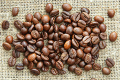 Coffee beans on the burlap. A heap of roasted coffee beans on the burlap Royalty Free Stock Photo