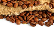 Coffee beans and burlap sack Royalty Free Stock Photos