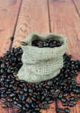 Coffee beans in burlap sack. Closeup of coffee beans in small burlap bag Royalty Free Stock Images
