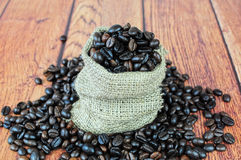 Coffee beans in burlap sack. Closeup of coffee beans in small burlap bag Stock Photos