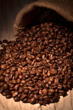 Coffee beans in burlap sack Royalty Free Stock Photography