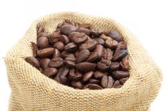 Coffee beans in burlap sack. Isolated on white Royalty Free Stock Image