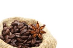 Coffee beans in burlap sack. Isolated on white Stock Photos