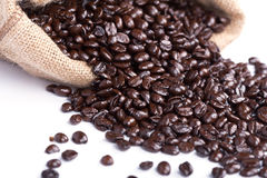 Coffee beans in burlap sack isolated on white Stock Image