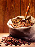 Coffee beans on burlap sack Stock Images