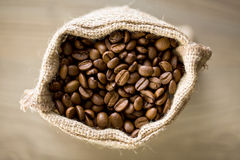 Coffee beans in burlap sack. Top view of coffee beans in burlap sack Royalty Free Stock Images