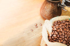 Coffee beans in burlap sack and turkish coffee pot Stock Image