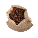 Coffee beans in burlap sack Stock Image