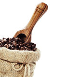 Coffee beans in burlap sack Stock Photography