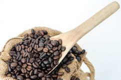 Coffee beans on burlap sack with wooden scoop Royalty Free Stock Photography