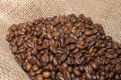 Coffee beans on burlap. Selective focus Royalty Free Stock Images