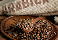 Coffee beans with a burlap and  spoon Stock Photography