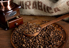 Coffee beans with a burlap and  spoon Stock Photos