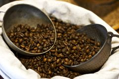 Coffee beans on a burlap suck. Silver coffee pot and cups. Coffee beans on burlap suck. Silver coffee pot and cups Stock Photography