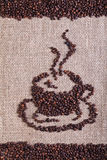 Coffee beans on burlap surface Stock Images