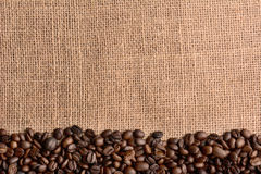 Coffee Beans on Burlap Surface Royalty Free Stock Image