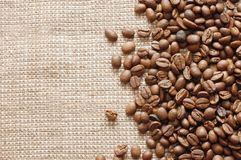 Coffee beans on a burlap texture Stock Photography