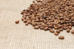 Coffee beans on a burlap texture background Royalty Free Stock Photo